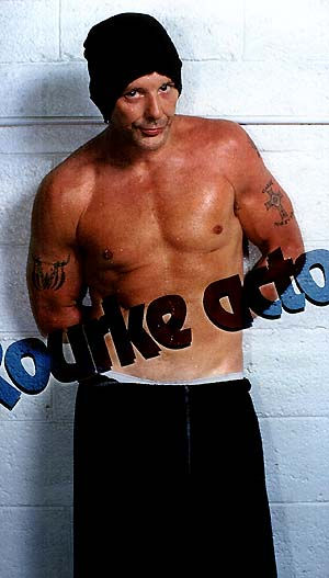 celebrity tattoos mickey rourke arms