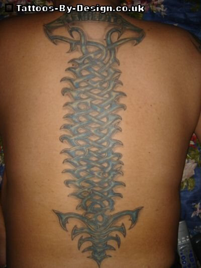 spine tattoos. flower tattoos on spine.
