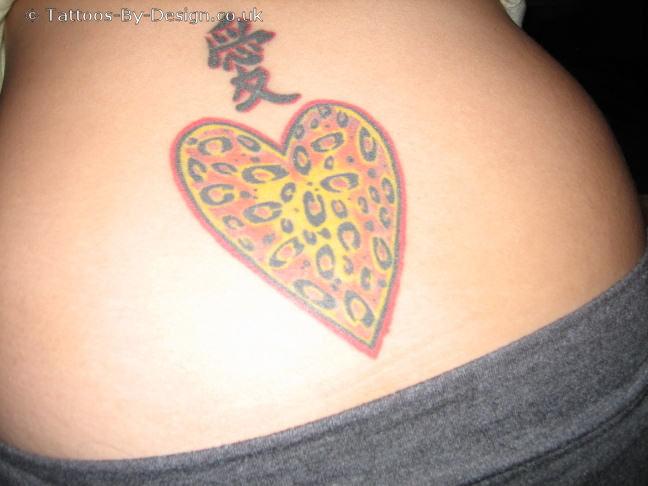 I wear my heart on my back tattoo for Tattoo shop name generator